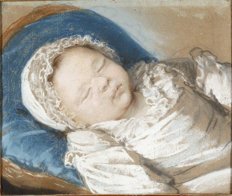 Enfant endormi sur un coussin